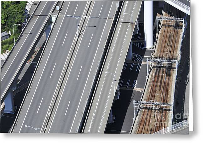 Osaka Greeting Cards - Road and rail intersection Greeting Card by Andy Smy