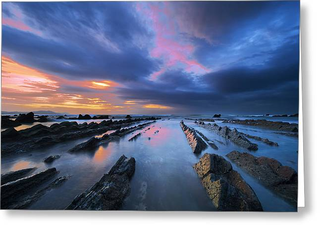 Rocks Greeting Cards - rocks in Barrika beach with dramatic sky Greeting Card by Mikel Martinez de Osaba
