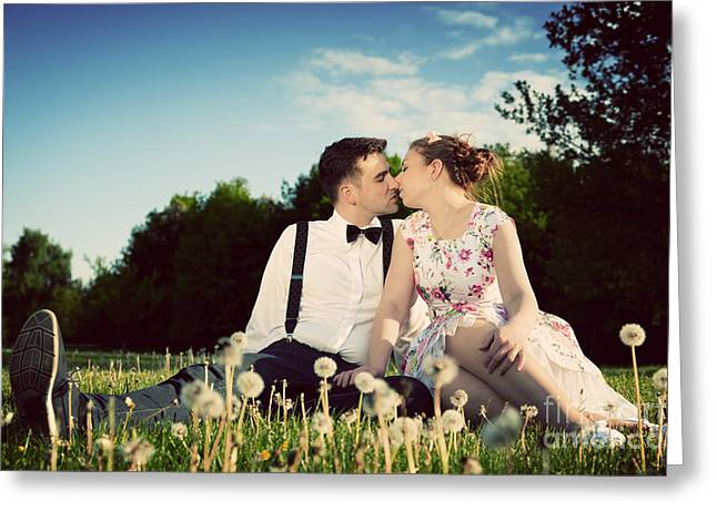 People Greeting Cards - Romantic couple in love about to kiss sitting on grass Greeting Card by Michal Bednarek