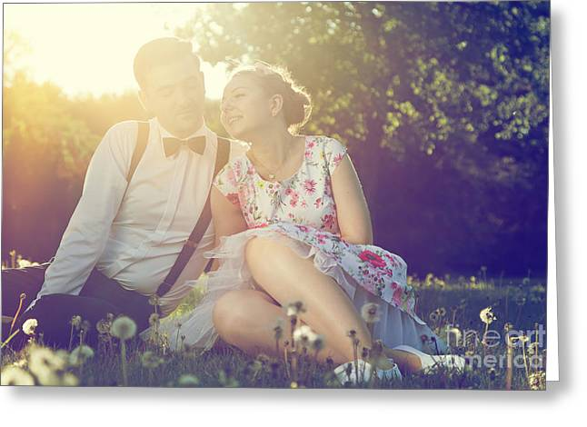 People Greeting Cards - Romantic couple in love flirting on grass in sunny park Greeting Card by Michal Bednarek