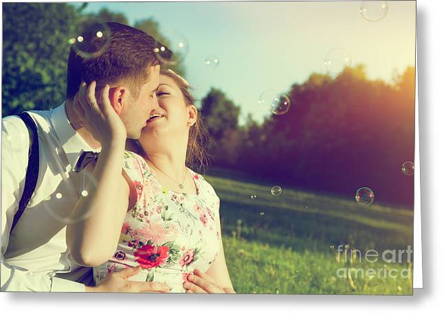 Romantic Couple Kissing With Love In Park Greeting Card by Michal Bednarek