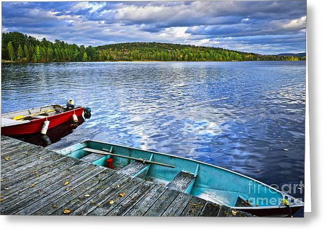 Rowboats on lake at dusk Greeting Card by Elena Elisseeva