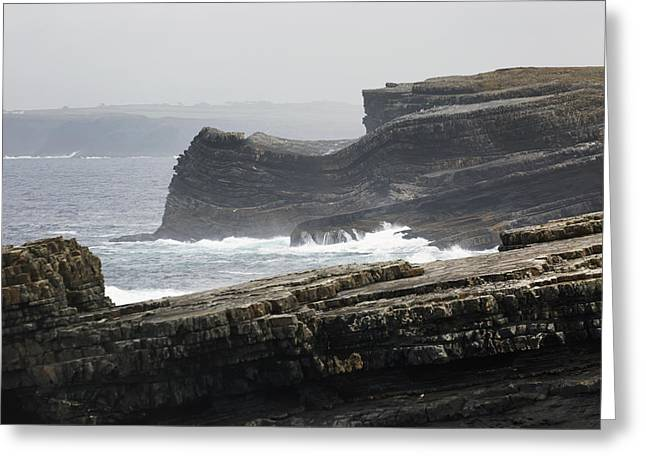 Foggy Ocean Greeting Cards - Rugged Dark Rocky Cliffs With Waves Greeting Card by Michael Interisano
