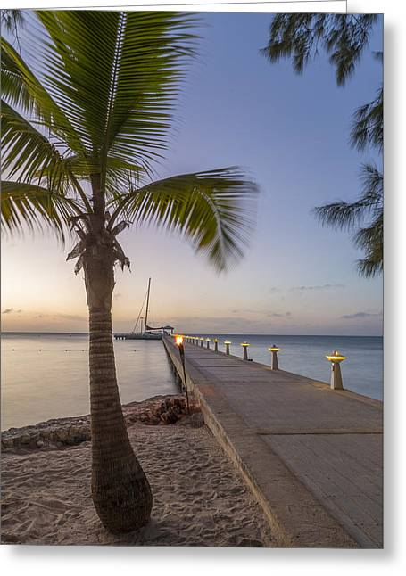 Rum Point Pier At Sunset Greeting Card by Adam Romanowicz