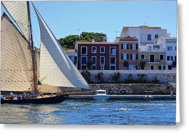 Docked Sailboat Greeting Cards - Sailboat in town - Es Castell in Menorca and the mediterranean at bottom Greeting Card by Pedro Cardona
