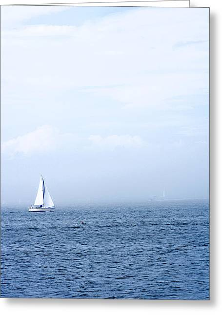 Sailboat Photos Greeting Cards - Sailboat On Water With Misty Sky Greeting Card by Gillham Studios