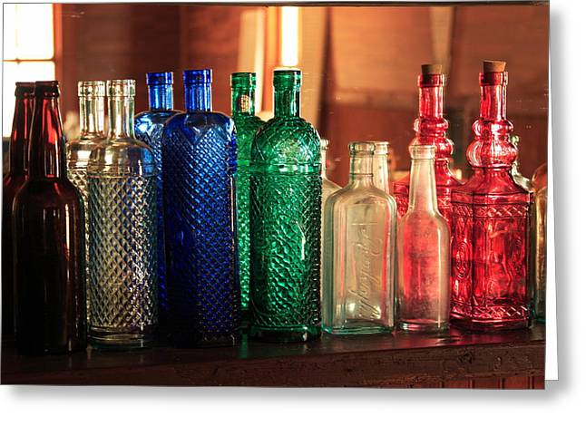 Glass Bottle Greeting Cards - Saloon bottles Greeting Card by Toni Hopper