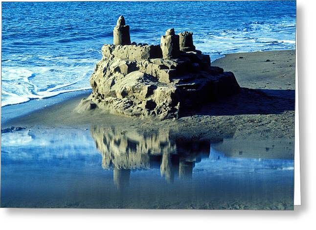 Sandcastle on beach Greeting Card by Garry Gay