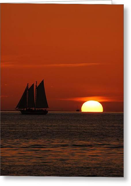 Schooner Greeting Cards - Schooner in red sunset Greeting Card by Susanne Van Hulst