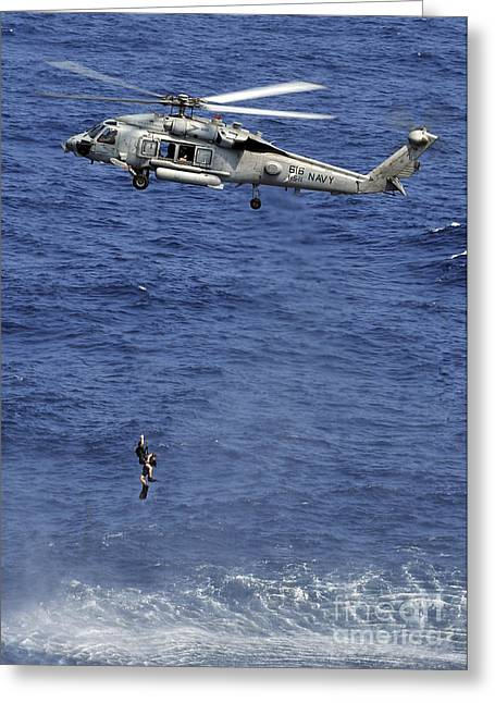 Hovering Greeting Cards - Search And Rescue Swimmers Greeting Card by Stocktrek Images