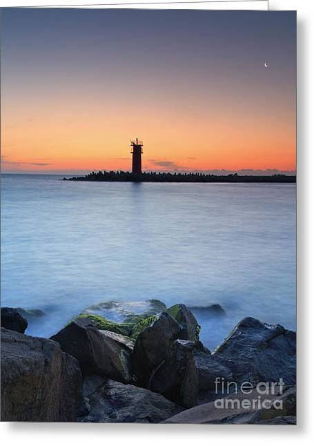 Ocean Sailing Greeting Cards - Seascape at sunset - lighthouse on the coast Greeting Card by Mohamed Elkhamisy