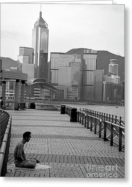 Wellbeing Greeting Cards - Seated man practicing yoga with view of skyline in the background Greeting Card by Sami Sarkis