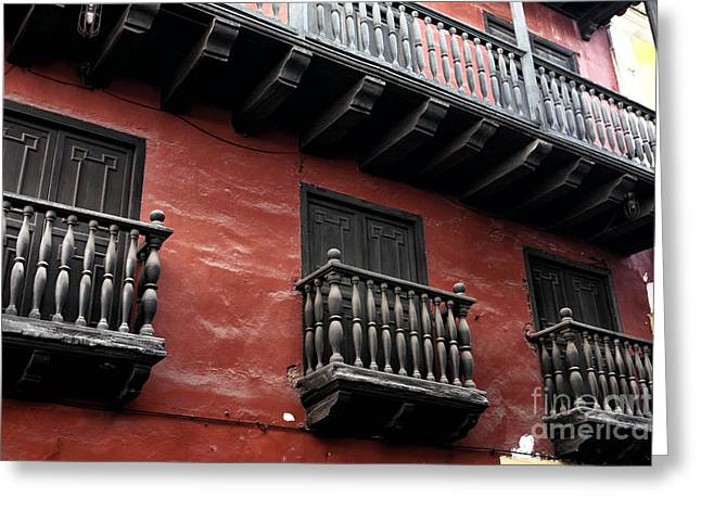 Red Buildings Greeting Cards - Seeing Red in Cartagena Greeting Card by John Rizzuto
