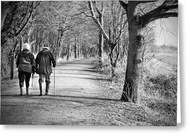 Older Couple Greeting Cards - Senior Couple Walking Through The Woods Greeting Card by Fizzy Image