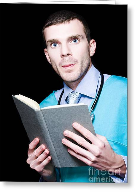 Advancement Greeting Cards - Serious Doctor Holding Medical Research Book Greeting Card by Ryan Jorgensen