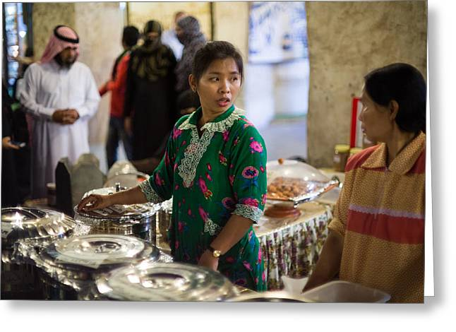 Serving Food In Doha Souq Greeting Card by Paul Cowan