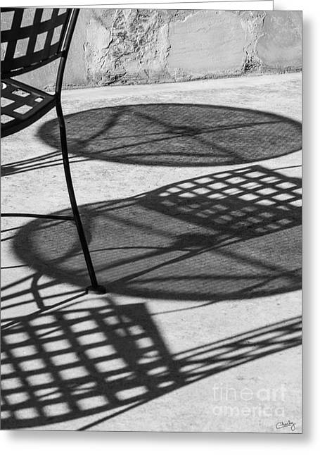 Patio Table And Chairs Photographs Greeting Cards - Shadows Of Outdoor Cafe Greeting Card by Imagery by Charly
