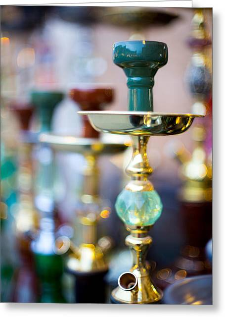Bubbly Greeting Cards - Shisha pipes lined up in a Doha Souq Greeting Card by Paul Cowan