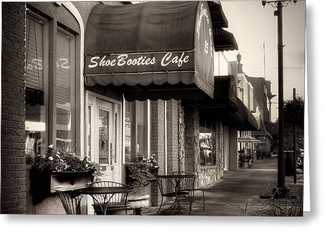 Table Greeting Cards - Sidewalk At ShoeBooties Cafe in Black and White Greeting Card by Greg Mimbs