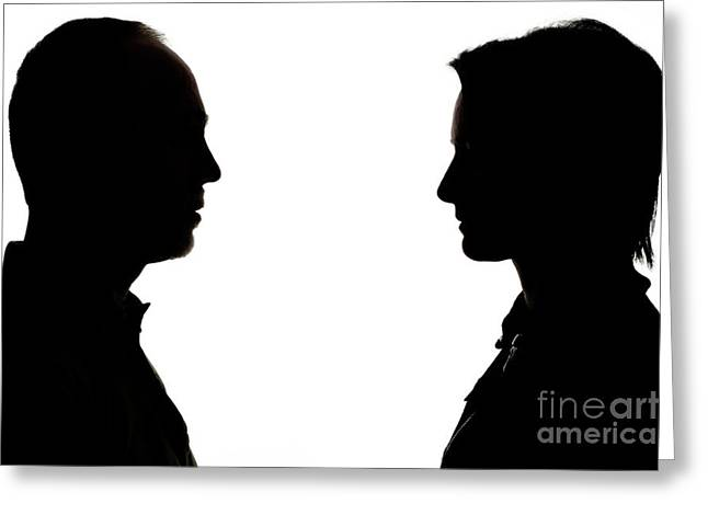 Equality Greeting Cards - Silhouette of man and woman face to face Greeting Card by Sami Sarkis
