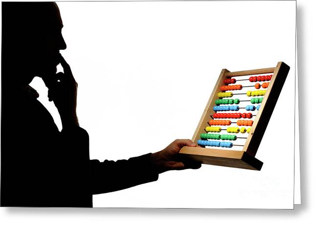 Concentration Greeting Cards - Silhouette of man holding abacus Greeting Card by Sami Sarkis