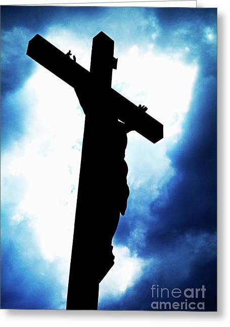 Crucifix Art Greeting Cards - Silhouetted crucifix against a cloudy sky Greeting Card by Sami Sarkis