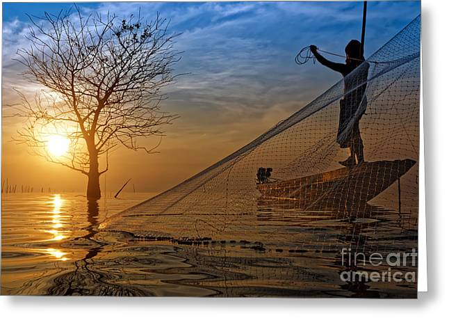 Smooth Pyrography Greeting Cards - Silhouettes fisherman throwing fishing nets during sunset. Greeting Card by Noppharat Manakul