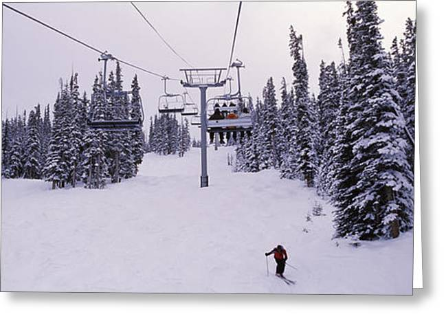Ski Resort Greeting Cards - Ski Lift Passing Over A Snow Covered Greeting Card by Panoramic Images