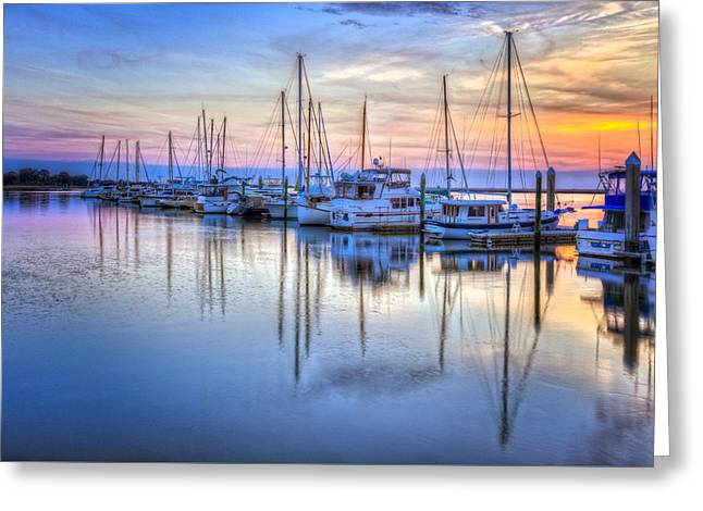Sailboats In Harbor Greeting Cards - Sliding into Sunset Greeting Card by Debra and Dave Vanderlaan