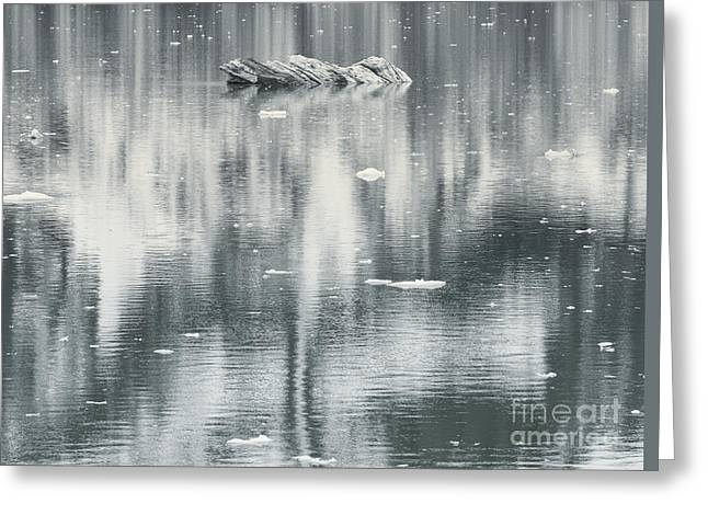 Glass Reflecting Greeting Cards - Small Ice formation and mountain reflection in water Greeting Card by Dani Prints and Images