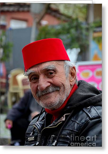 Eyebrow Greeting Cards - Smiling happy old Turkish senior man in fez and leather jacket Greeting Card by Imran Ahmed
