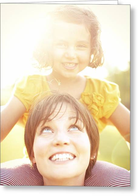 Sun Flare Greeting Cards - Smiling Mother Holding Daughter Greeting Card by Gillham Studios