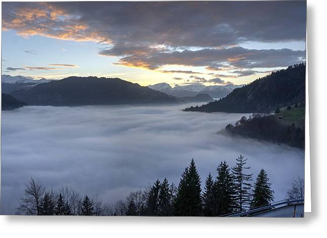 Graubunden Greeting Cards - Smoke in the valley fire in the sky Greeting Card by Peter Thoeny