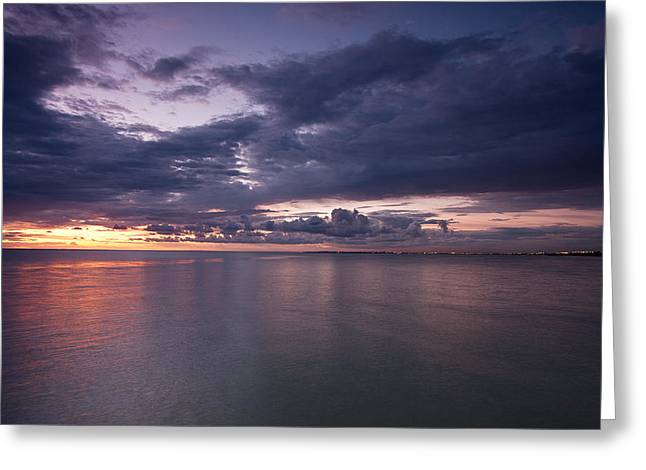 Surf City Greeting Cards - Smooth water surface with distant Melbourne lights Greeting Card by Greg Brave