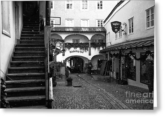 Salzburg Greeting Cards - Snow on the Cobblestone Greeting Card by John Rizzuto