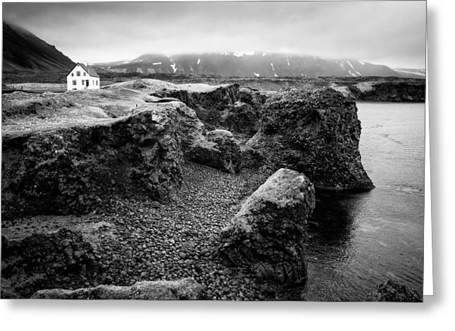 Cliffs And Water Greeting Cards - Solitary house at Arnarstapi coast Iceland black and white Greeting Card by Matthias Hauser