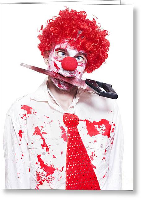 Spooky Clown Holding Bloody Saw In Mouth On White Greeting Card by Jorgo Photography - Wall Art Gallery