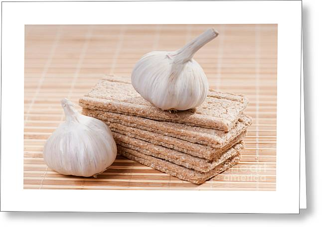 Wholewheat Greeting Cards - Stack of dry crisp bread slices with garlic  Greeting Card by Arletta Cwalina
