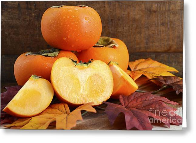 Tabletop Greeting Cards - Stack of fresh Persimmons  Greeting Card by Milleflore Images