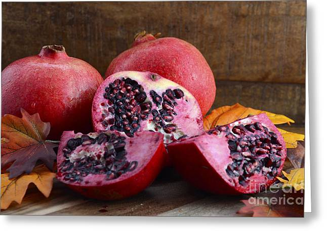 Tabletop Greeting Cards - Stack of fresh pomegranates  Greeting Card by Milleflore Images