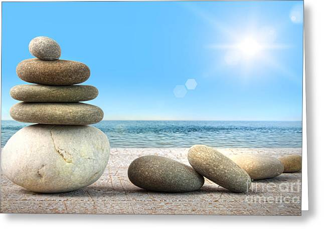 Stationary Greeting Cards - Stack of spa rocks on wood against blue sky Greeting Card by Sandra Cunningham