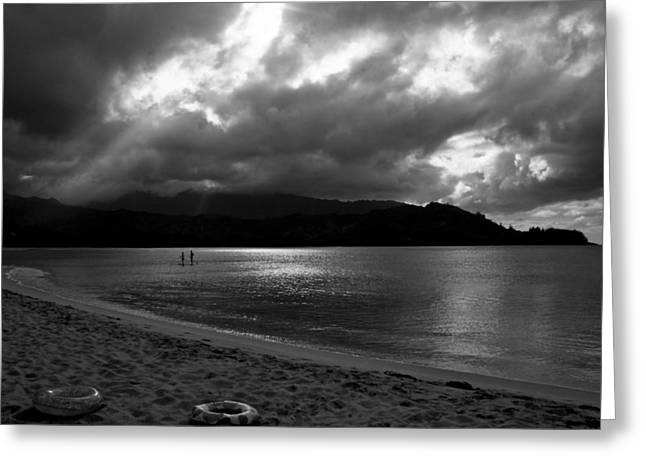 Stand Up Paddlers in Stormy Skies Greeting Card by Lennie Green