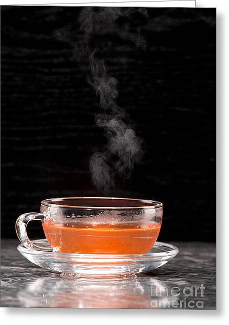 Beverage Greeting Cards - Steaming tea in glass cup Greeting Card by Wolfgang Steiner