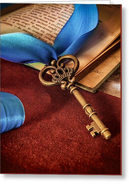 Book Cover Art Greeting Cards - Still life with brass ornamented key and blue ribbon Greeting Card by Jaroslaw Blaminsky