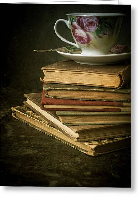 Information Age Photographs Greeting Cards - Still life with old books and the teacup Greeting Card by Jaroslaw Blaminsky