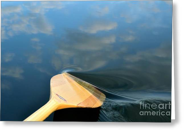 Canoe Greeting Cards - Stirring up the Clouds Greeting Card by Nancy Anderson