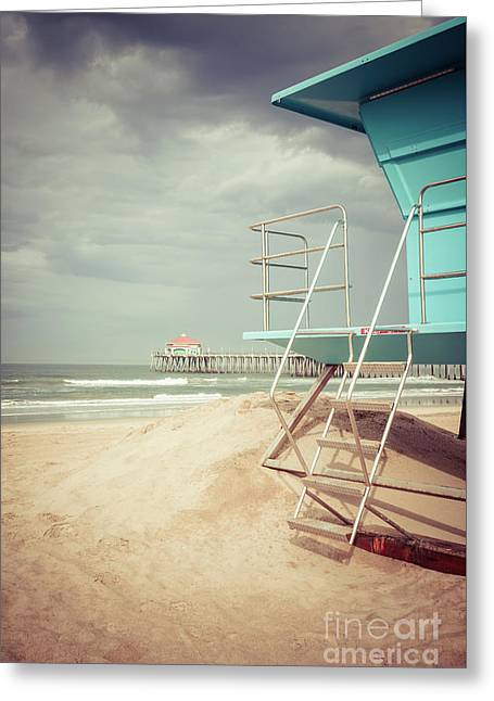 Stormy Huntington Beach Pier And Lifeguard Stand Greeting Card by Paul Velgos