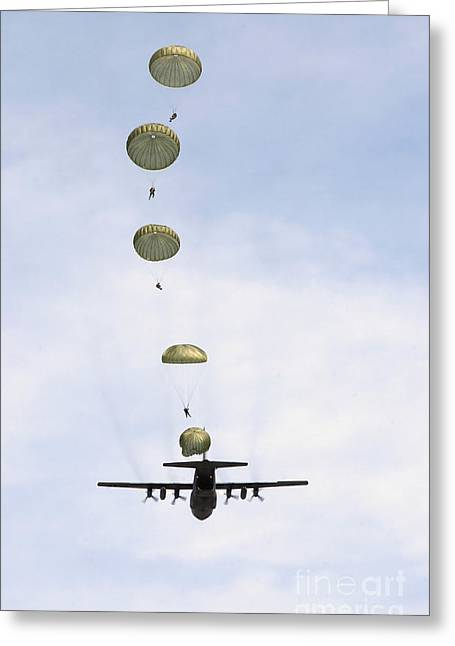 C-130 Greeting Cards - Students Jump From A C-130 Hercules Greeting Card by Stocktrek Images
