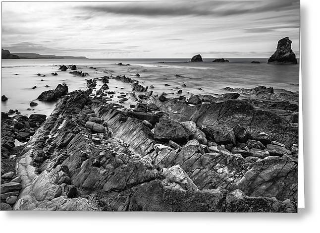 Blue And Green Greeting Cards - Stunning tonal black and white landscape of Mupe Bay with rocks  Greeting Card by Matthew Gibson