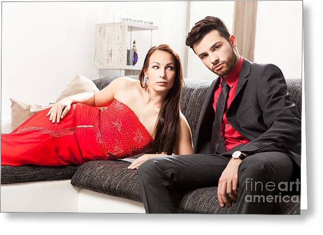 Team Mates Greeting Cards - Stylish young couple on a couch Greeting Card by Wolfgang Steiner